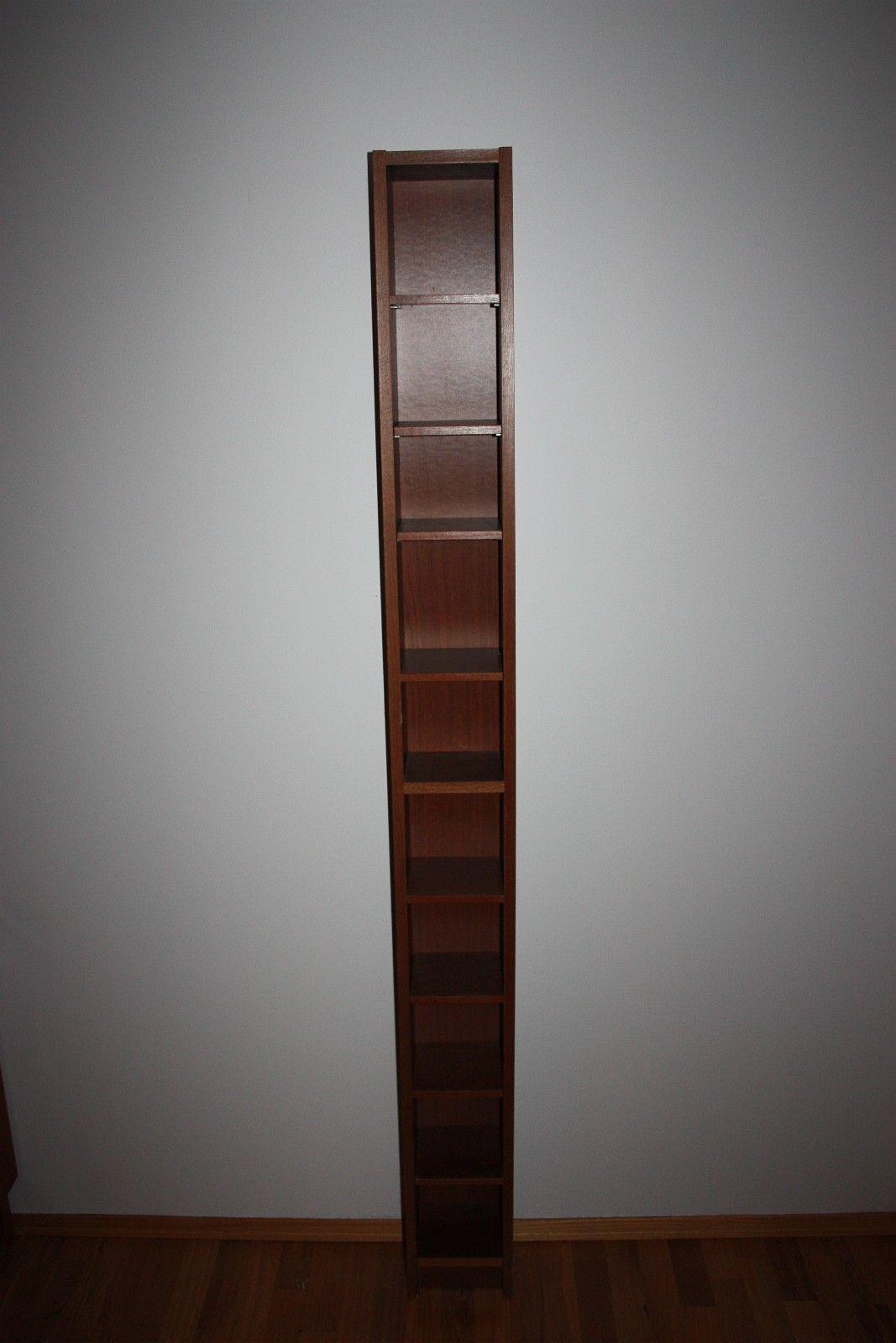 Benno cd-hyller: To stk lys bjørkefinér, én brun - Rådal  - Har tre Benno cd-hyller som jeg gir vekk.  To av dem er i lys bjørkefinér, og en er brun.  Kan også brukes til bøker, filmer, pyntegjenstander m.m.  Mål: 202 X 20 X 17 cm. - Rådal