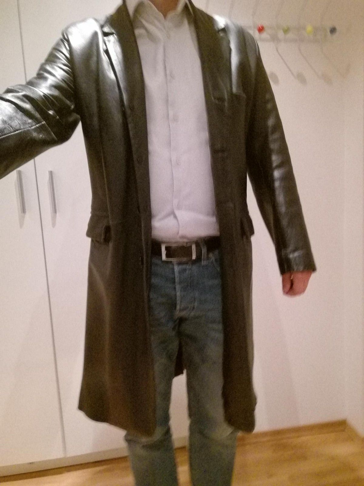 Men's long leather jacket, size S, black - Oslo  - Men's long leather jacket, size S, black. I'm medium size myself and the jacket fits, so I'd consider it large size S. - Oslo