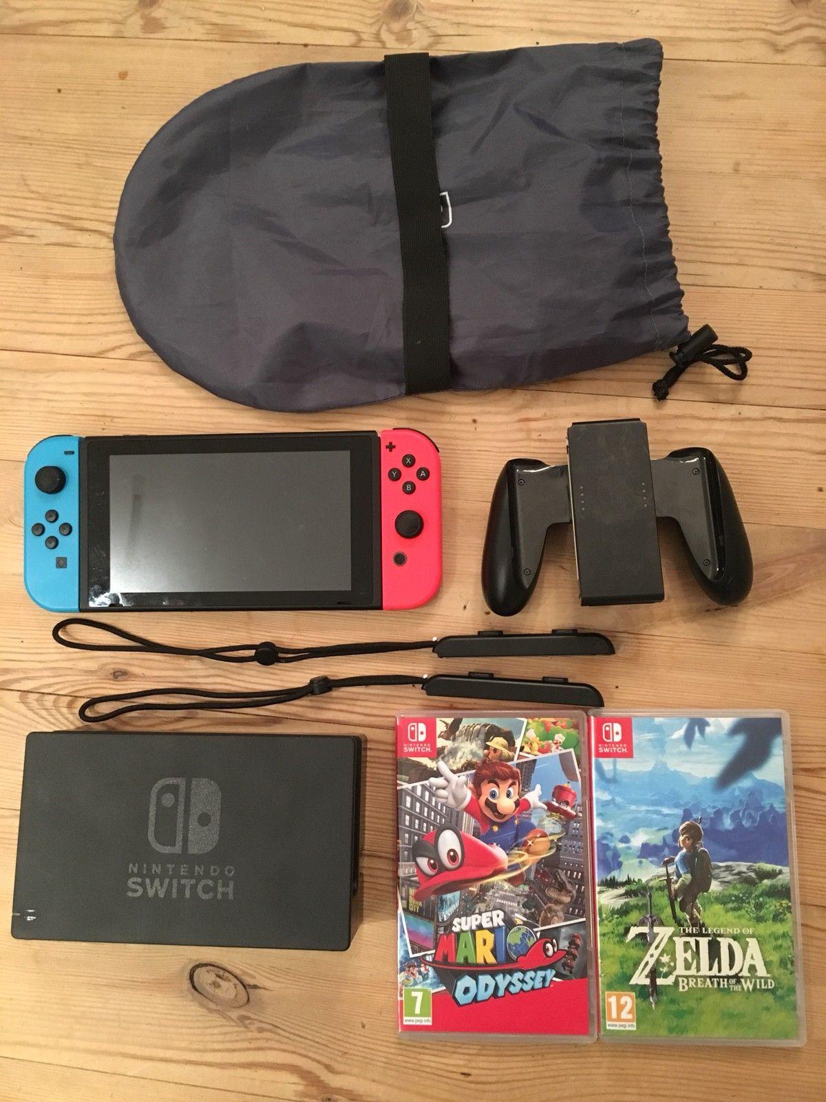 Nintendo switch med 4 spill - Oslo  - Nintendo switch Neon farget. I veldig fin stand.  Inkluderer 4 spill: - Zelda Breath of the Wild - Super Mario Odyssey - Mario Kart Deluxe 8 - Shovel Knight Treasure Trove  Inkluderer alt på bildene med HDMI-kabel og strø - Oslo