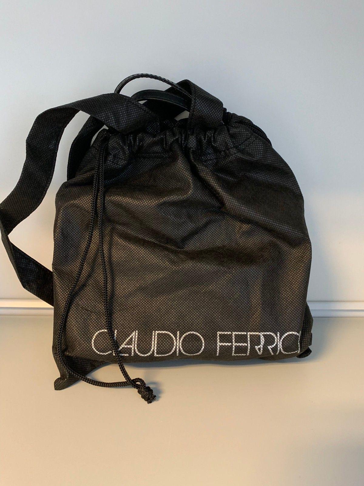 Liten Claudio Ferrici skinn veske med håndtak. | FINN.no