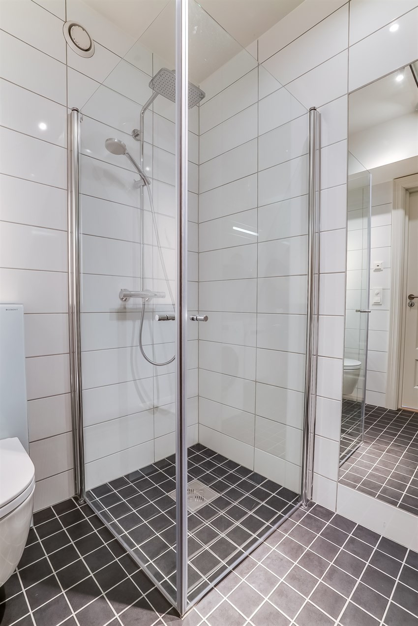 Dusjhjørne som gir full utnyttelse av badet sin størrelse