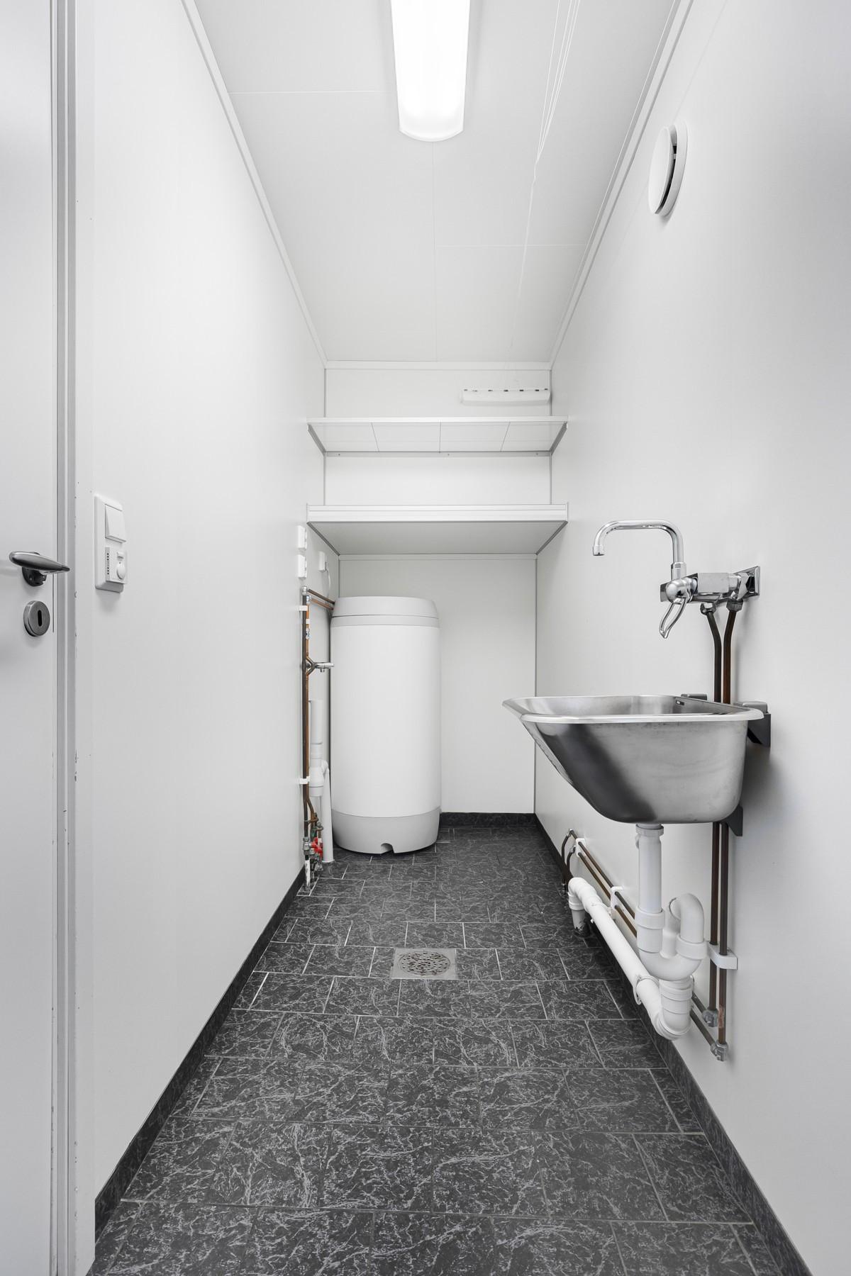 Flislagt vaskerom med gulvvarme