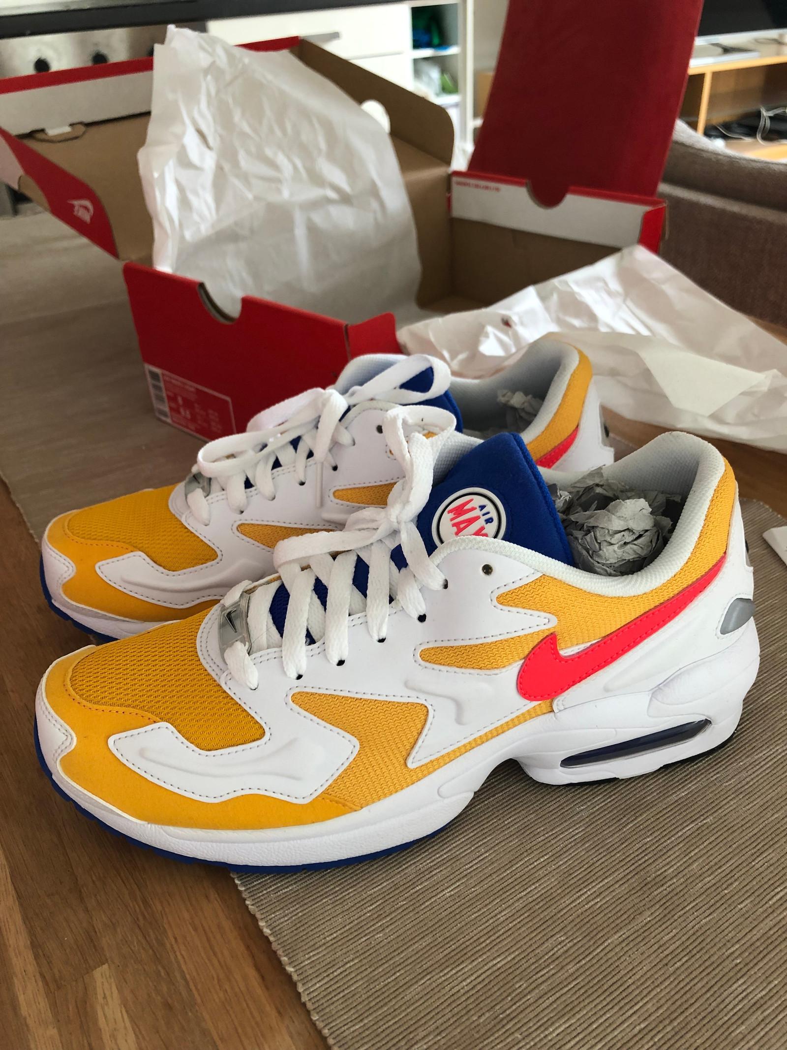 Tênis Adidas NMD HU Pharrell Williams Solar Pack
