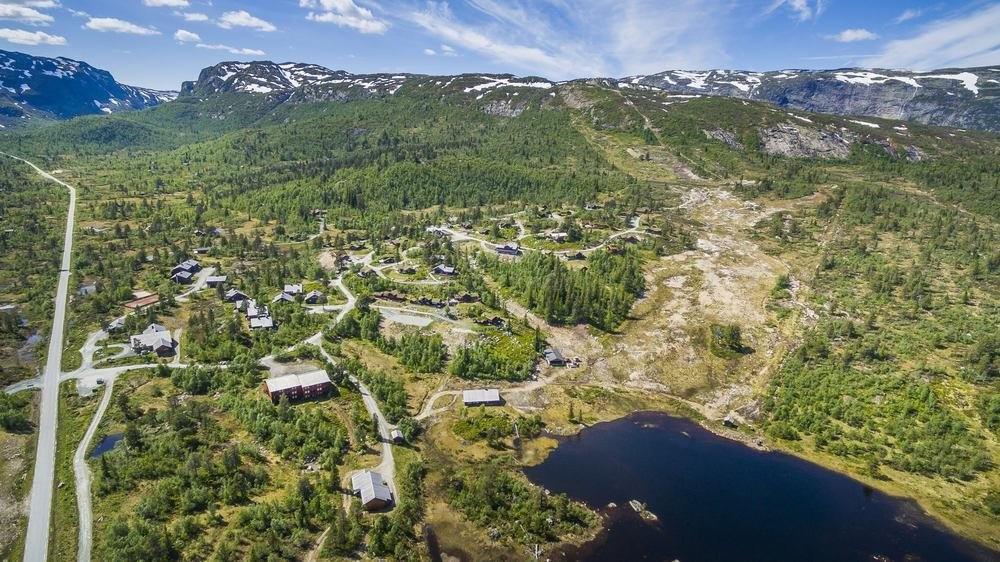 Det nye tomteområdet ligger til venstre av alpin - trasen øverst i feltet.