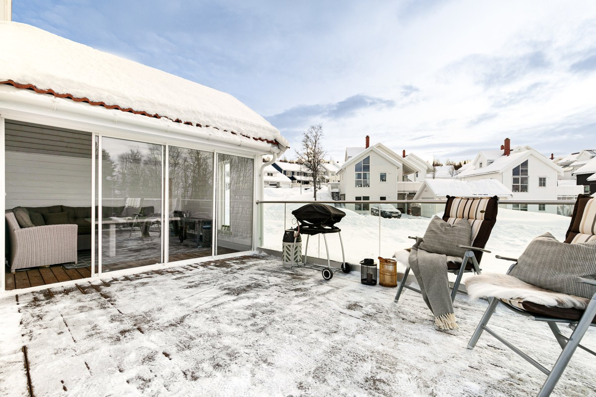 Vinterhage med skyvedører i på terrasse