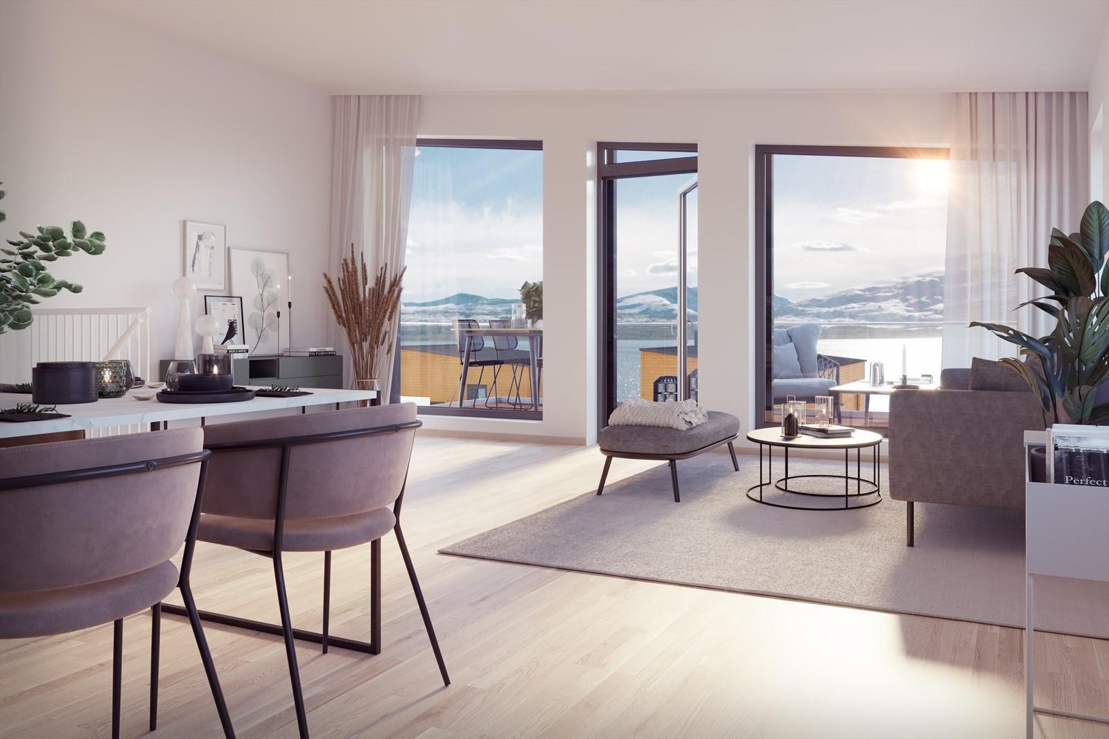 Flott åpen løsning i stue / kjøkken og store vindusflater som gir nydelig utsikt