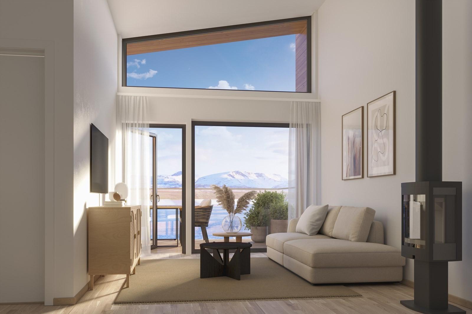 Vedfyring og utsikt er en uslåelig kombo. Dette er fra stue 4-roms leilighet (alternativ med soverom).