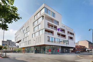 Kvadraturen/Q42-Flott hjørneleilighet m/flott utsikt over Otra-Fast P-plass i kjeller inkl. i prisen-Heis-Stor balkong