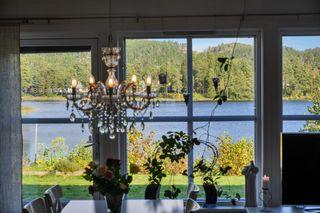 Tøane - Pen, romslig og solrik vertikaldelt tomannsbolig med 4 soverom, garasje og flott utsikt