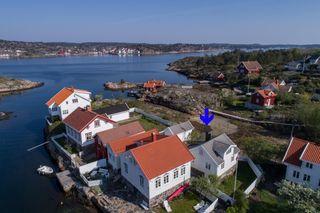 Koselig enebolig med frittliggende uthus i Lille Svalsund - Tinglyst båtplass - Oppussingsbehov