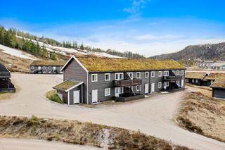 """Praktisk og familievennlig leilighet med sentral og solrik beliggenhet, """"ski in/out"""" / ingen utleieplikt"""