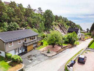 Innholdsrik enebolig på Fevik - solrikt - utsikt utover havet - kort vei til Strand hotell - barnevennlig