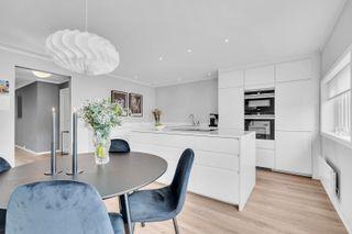 Smakfull 4-roms andelsleilighet med garasje i rekke - Vestvendt takterrasse - Heis - Modernisert
