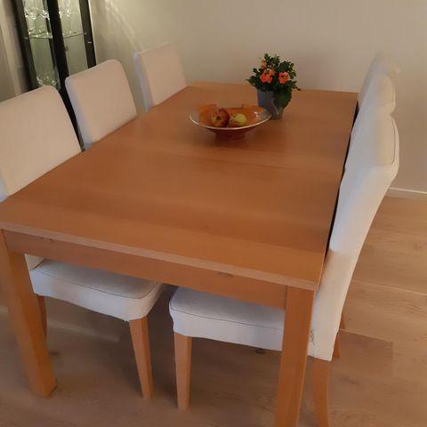 Aannø Sigma spisestue med seks stoler og innleggsplate