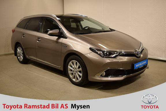Toyota Auris Touring Sports 1,8 Hybrid Executive m. panoramatak  2015, 30 300 km, kr 249 000,-