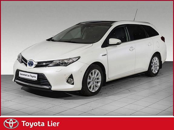 Toyota Auris 1,8 Hybrid Executive HSD Pen bil med komplett service.  2014, 43000 km, kr 199000,-