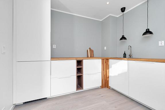 Kjøkken med integrerte hvitevarer - Mulighet for å supplere innredningen med overskap dersom ønskelig